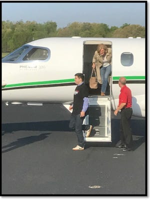 U.S. Rep. Diane Black exits a plane affiliated with the owners of Fitzgerald Glider Kits.