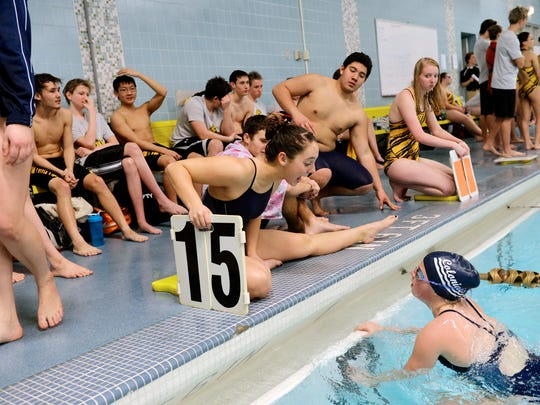 New Oxford's Rachel Groden, center, cheers on teammate