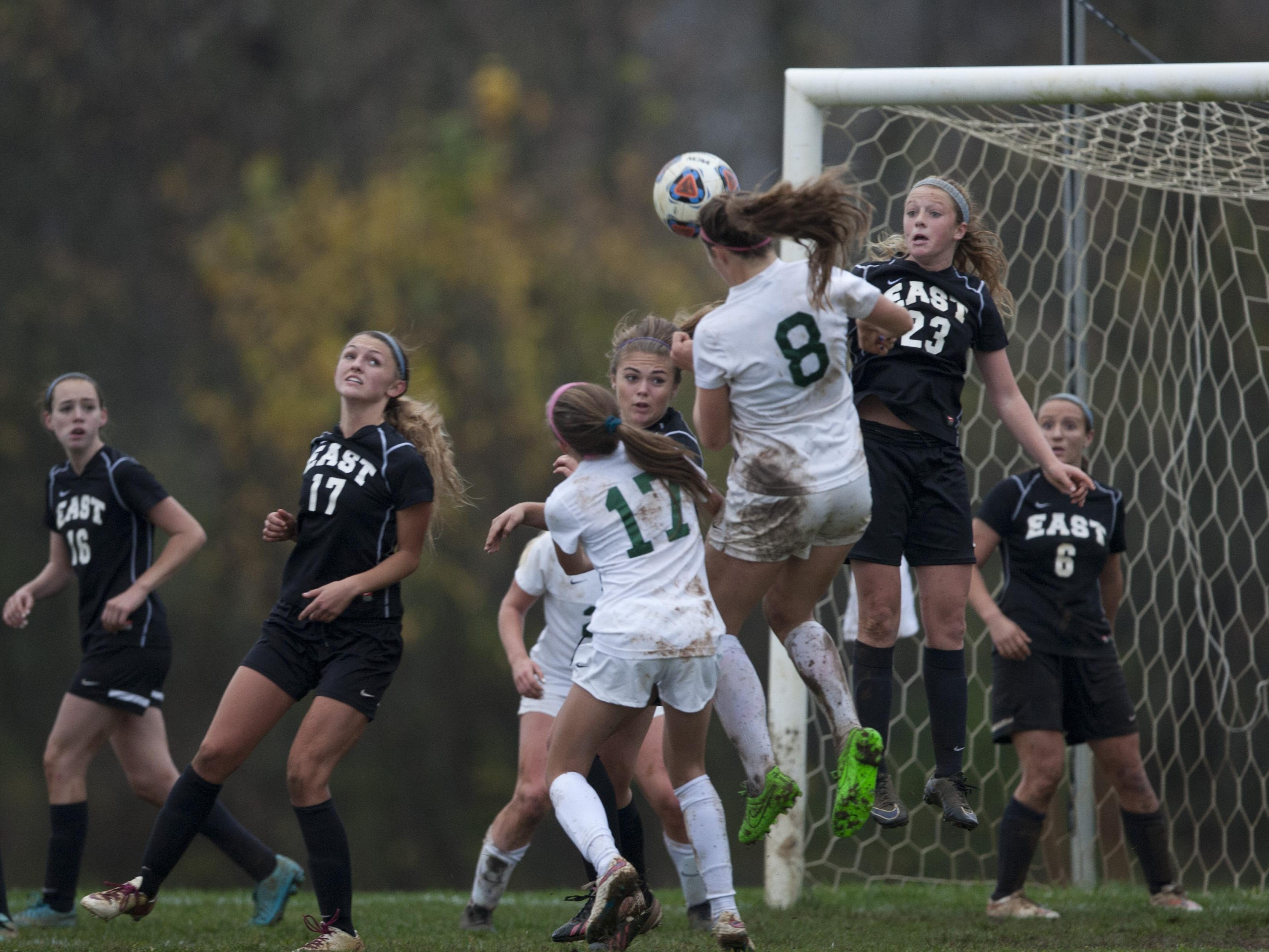 Colts Neck's Amanda Visco heads in here team's second goal of game. Colts Neck defeats Toms River East in NJSIAA girls soccer Central Group III final in Colts Neck on November 12, 2015