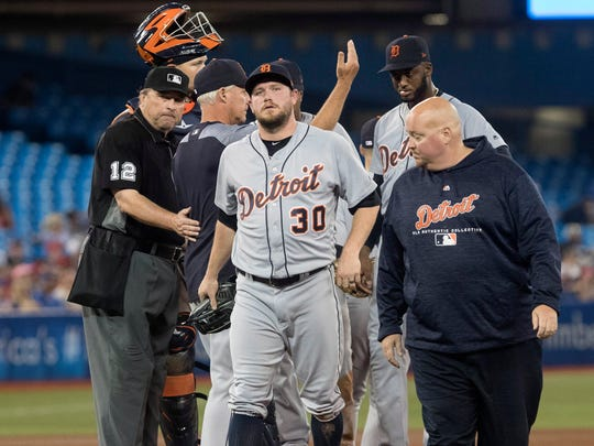 Detroit Tigers pitcher Alex Wilson leaves with an injury