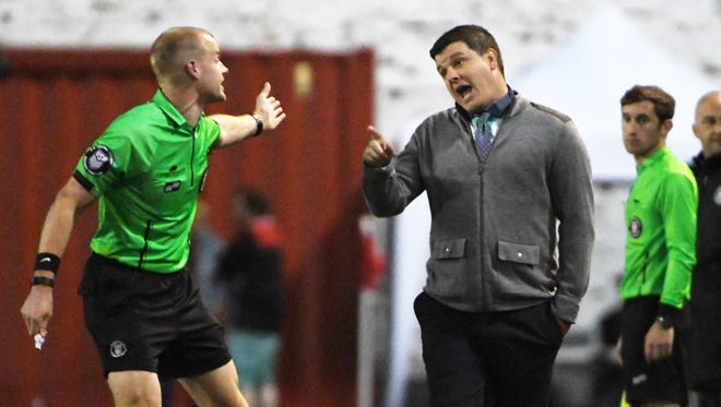 DCFC head coach Ben Pirmann, right, thought his team played well despite Sunday's result.