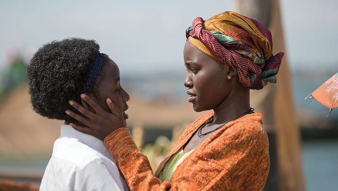 """Madina Nalwanga (left) plays a young girl defying the odds to become a chess champion, with the support of her mother (Lupita Nyong'o) in """"Queen of Katwe."""""""