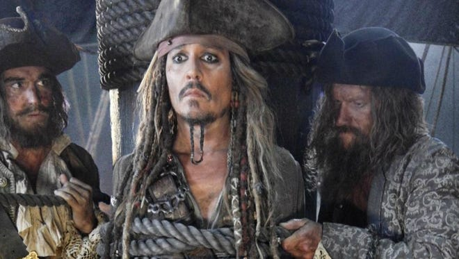 "Favoring eyeliner over eye patches, Johnny Depp returns as Captain Jack Sparrow in ""Pirates of the Caribbean: Dead Men Tell No Tales."""