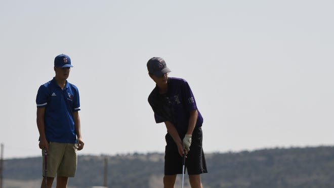 Rye High School junior Chance Donlon, right, putts on the 12th hole during the Class 3A Region 1 boys golf tournament Tuesday at Hollydot Golf Course in Colorado City. Donlon shot a 72 and finished second to qualify for the state tournament Oct. 5-6 in Gunnison.