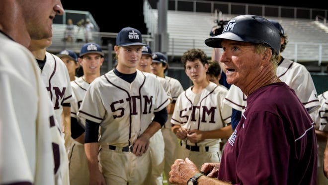 St. Thomas More head coach Gary Perkins speaks to payers following the LHSAA Class 4A state semifinal playoff game at McMurry Park in Sulphur, LA, Thursday, May 14, 2015. St. Thomas More defeated St. Michael 12-2 and will face Teurlings Catholic in the state final on Saturday
