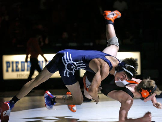 Piedra Vista's Dylan Greenhaus takes down Monticello's Steven Robinson during their match at 120 pounds during Friday's dual meet at the Jerry A. Conner Fieldhouse in Farmington.