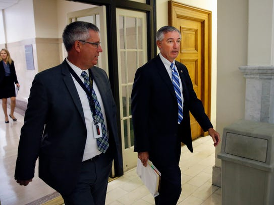 Montgomery County District Attorney Kevin Steele, right,