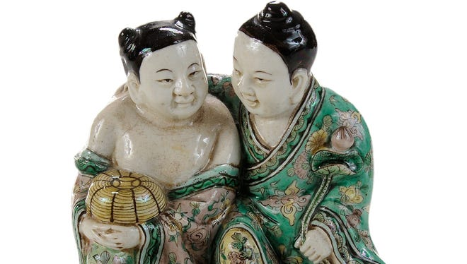 These twin boys, according to Chinese legend, will bring a happy marriage to the owner. But they must wait for another sale, because this time there was no bid high enough to buy the twins.
