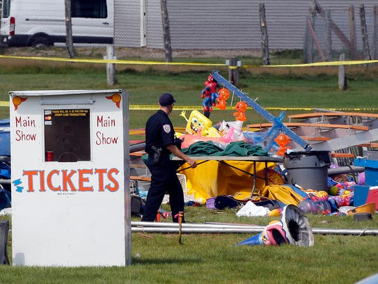 Investigators inspect the site of a circus tent that