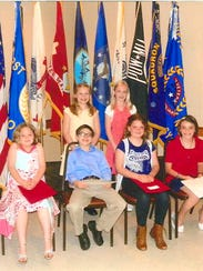 Poster Winners in grades 2 through 5, front row, from