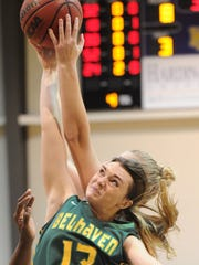 Belhaven's Candler Gregory (13) battles a Hardin-Simmons player for a rebound. The Blazers beat HSU 75-65 on Saturday, Dec. 17, 2016 at the Mabee Complex.