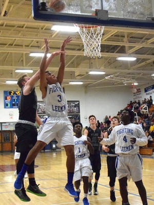 Robert E. Lee's Jayden Williams goes up for a shot as Wilson Memorial's Jacob Sears defends from behind in the first half of their Shenandoah District boys basketball tournament semifinal game on Wednesday, Feb. 14, 2018, at Robert E. Lee High School in Staunton, Va. The Leemen won 74-55 to advance to Friday's final against East Rockingham.