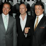 Arnold Schwarzenegger, left, Bruce Willis and  Sylvester Stallone arrive at the premiere of 'The Expendables' at Grauman's Chinese Theatre on Aug. 3, 2010, in Hollywood.