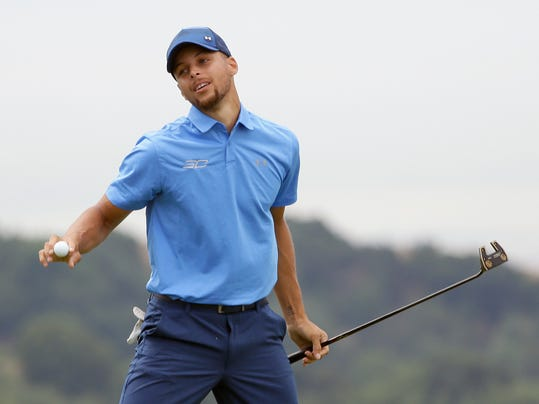 Golden State Warriors NBA basketball player Stephen Curry reacts after making a putt to save par on the 18th green during the Web.com Tour's Ellie Mae Classic golf tournament Thursday, Aug. 3, 2017, in Hayward, Calif. (AP Photo/Eric Risberg)