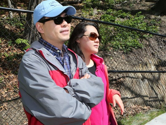 DJ Nam and Mi Chung from Ossining, prepare to take a walk along the Sing Sing Kill Greenway.
