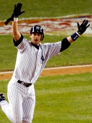 Former New York Yankee and now-manager Aaron Boone celebrates his game-winning home run off Boston Red Sox  pitcher Tim Wakefield in the 11th inning of  Game 7 of the American League Championship Series in 2003.