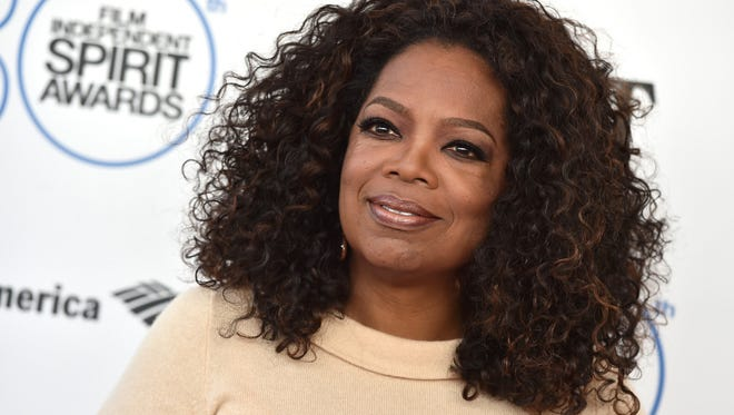 Oprah Winfrey arrives at the 30th Film Independent Spirit Awards in Santa Monica, Calif.