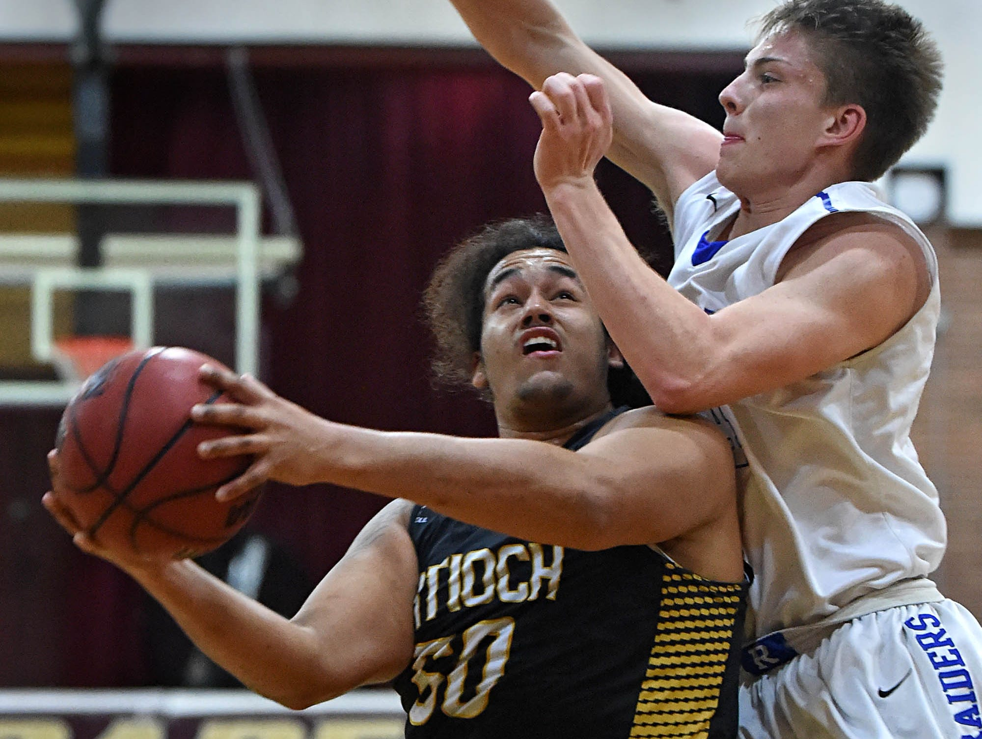 Reed's Grant Cotter looks to block a shot by Anitoch's Sir Forbes during the Rail City Classic Basketball Tournament at Sparks High School on Tuesday/.