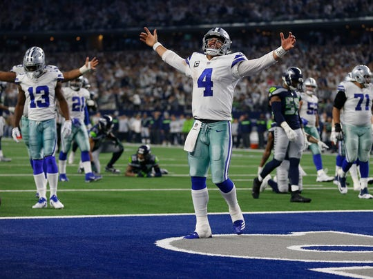 Dallas Cowboys quarterback Dak Prescott (4) celebrates