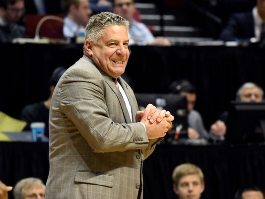 Auburn coach Bruce Pearl reacts during the second half of the team's second-round NCAA college basketball tournament game against Clemson on Sunday, March 18, 2018, in San Diego. (AP Photo/Denis Poroy)