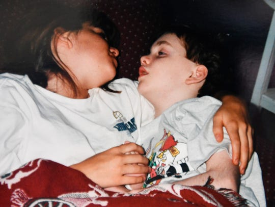 Ashlee K Thomas, left, at age 14, with her then 11-year-old