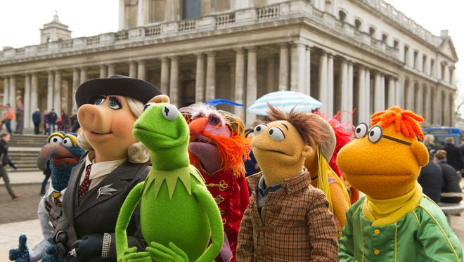 Gonzo, left, Miss Piggy, Kermit, Floyd, Walter and Scooter hit Europe in 'Muppets Most Wanted.'