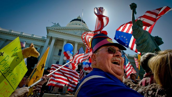 Bert Maxwell, 82, from Sonora, Calif.,  attends a tax day rally in Sacramento on April 15, 2009. Thousands of protesters, some dressed like Revolutionary War soldiers, gathered for a series of rallies modeled after the original Boston Tea Party.