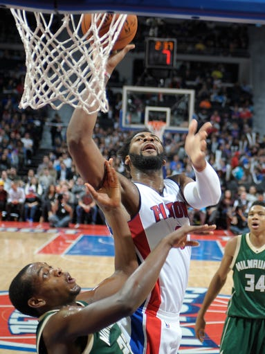 Pistons' Andre Drummond shoots over the Bucks' Khris