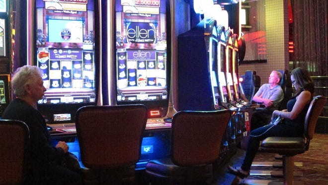 Gamblers sit at slot machines at the Golden Nugget casino in Atlantic City in June. There are two ballot questions before New Jersey voters. One asks whether casino gambling should be expanded to two as-yet unidentified locations in northern New Jersey.