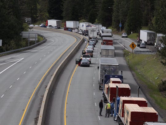 Traffic backs up on Interstate 5 south of Castella in Siskiyou County after an overturned big rig blocked two lanes.