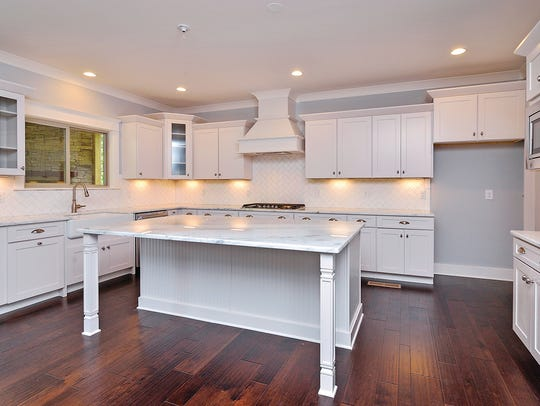 Oversized work islands and open kitchen layouts characterize
