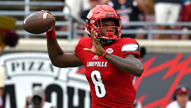 Louisville quarterback Lamar Jackson looks for a receiver during the first quarter against Florida State on Sept. 17, 2016.