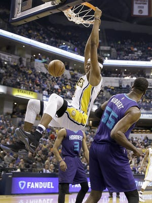 Indiana Pacers center Myles Turner (33) dunks the ball over Charlotte Hornets center Roy Hibbert (55) in the first half of their game Monday, December 12, 2016, evening at Bankers Life Fieldhouse.