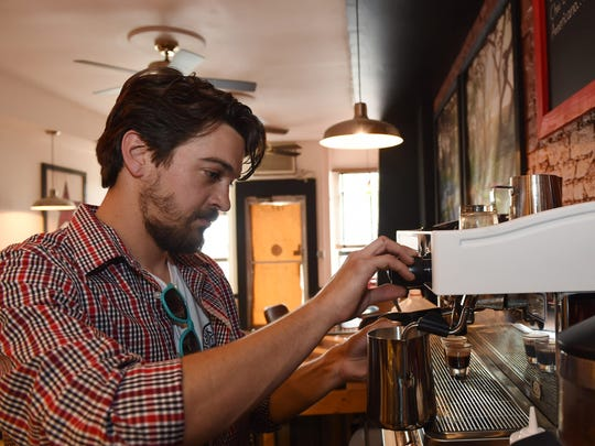 Patrick McGuire preparers a cappuccino at  the Poughkeepsie