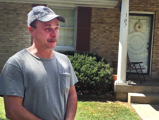 Standing outside the family's home, Steven Dodd's father