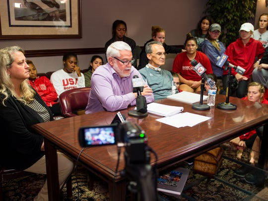Michael Lotief speaks with media after being fired as Head Coach of Louisianas Ragin Cajun Softball.  Wednesday, Nov. 1, 2017. (Seated at table L-R, Stefni Lotief, Attorney Glenn Edwards, and Michael Lotief)