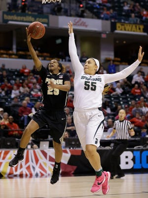 Purdue guard April Wilson (25) shoots under Michigan State forward Kennedy Johnson (55) in the second half of a Big Ten Conference tournament game in Indianapolis on Friday. Michigan State defeated Purdue 65-64.