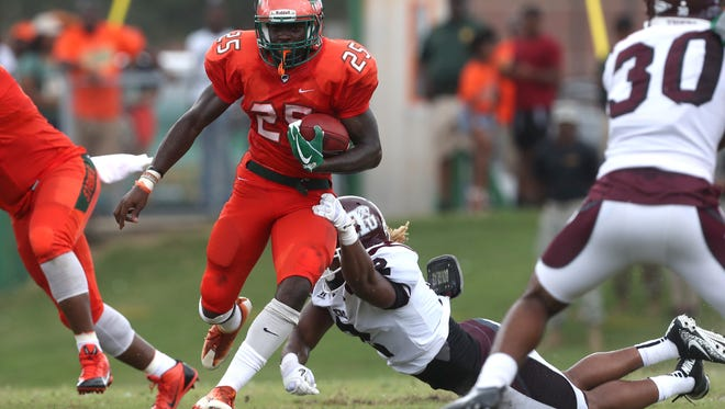 FAMU's Devin Bowers  runs the ball against Texas Southern during the Rattlers home opener at Bragg Stadium on Saturday, Aug. 26, 2017.