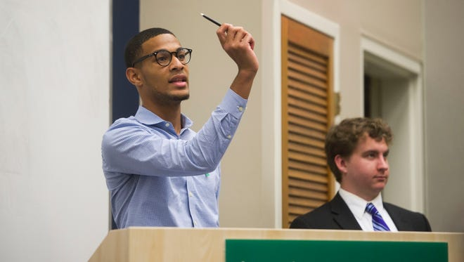 Mustafa Ali-Smith, president of the Student Political Alliance opens a forum hosted by the Student Political Alliance about mental health on campus and suicide prevention, in the Walters Life Sciences building Tuesday, Oct. 10, 2017.