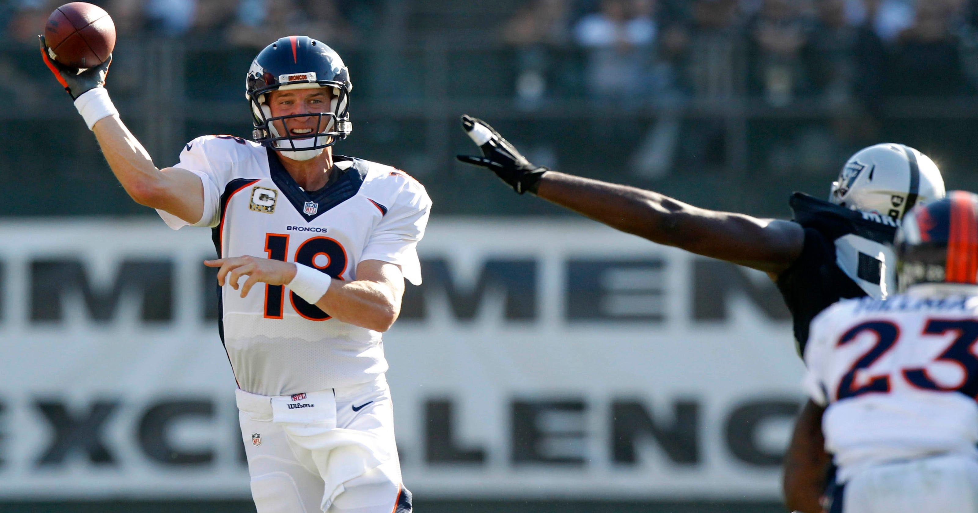 99b4304221b Manning s 5 TDs lead Broncos past Raiders 41-17