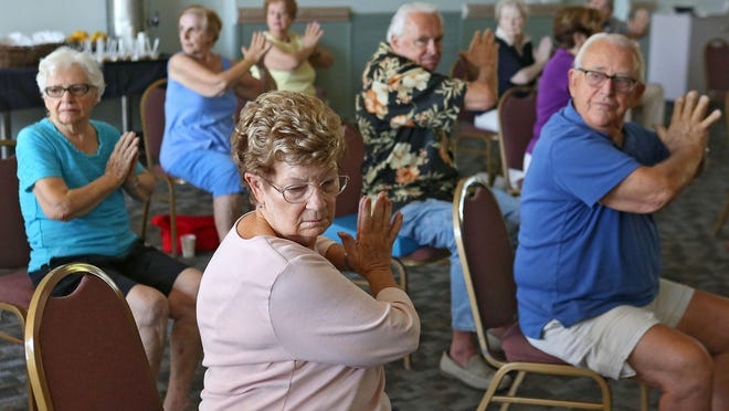"""Kay Palmer, center, performs an exercise during a balance and coordination class at the Mizell Senior Center as part of the center's """"National Fall Prevention Day"""" activities, Wednesday, September 23, 2015."""