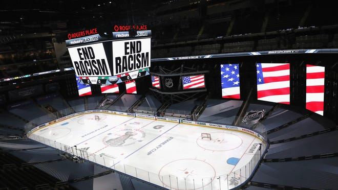 """""""End Racism"""" is displayed on the scoreboard Wednesday at Rogers Place in Edmonton, Alberta."""