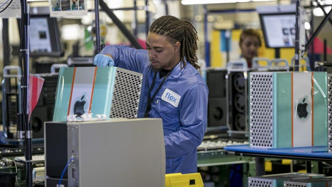 A Flextronics employee assembles an Apple Mac Pro computer in Austin last year. Factory output in Texas has continued to improve after a pandemic-induced downturn earlier this year, according to a new report from the Federal Bank of Dallas.