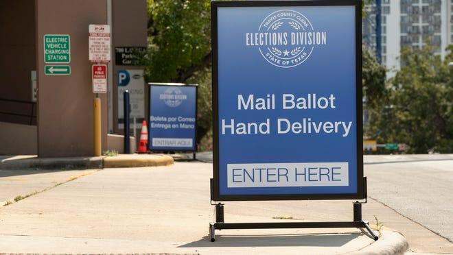 A sign indicates a drive-through ballot drop off location at the 700 Lavaca Parking Garage in Austin, Texas, on Thursday Oct. 1, 2020, shortly after an order was announced by Gov. Greg Abbott restricting such drop off locations. The number of locations where Texas voters can drop off their mail-in ballots has been vastly reduced to ensure poll security, Gov. Greg Abbott said Thursday.