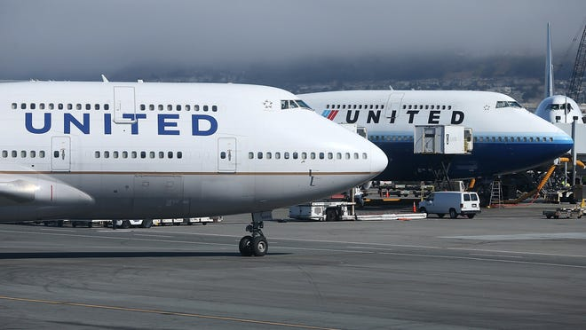 United Airlines planes at San Francisco International Airport on July 25, 2013.