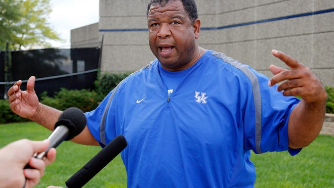 Kentucky tight end coach Vince Marrow speaks with reporters after football practice on campus in Lexington. Aug. 12, 2014