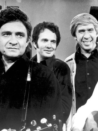 From left, country singers Johnny Cash, Merle Haggard,