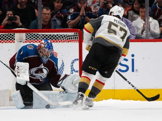 Colorado Avalanche goaltender Semyon Varlamov, left, stops the shot of Vegas Golden Knights left wing David Perron in the shootout session of an NHL hockey game Saturday, March 24, 2018, in Denver. Colorado won 2-1. (AP Photo/David Zalubowski)