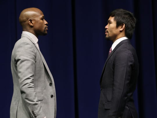 Floyd Mayweather Jr. and Manny Pacquiao meet face to face at the Nokia Theater in Los Angeles on March 11, 2015 as part of their only promotional press conference prior to their May 2, 2015 bout in Las Vegas.