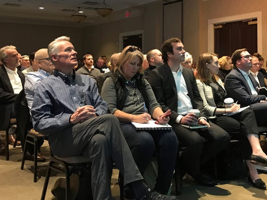 Spectators, including Lee Beaman, treasurer of the political action committee NoTax4Tracks, watch speakers critique Mayor Megan Barry's mass transit plan.